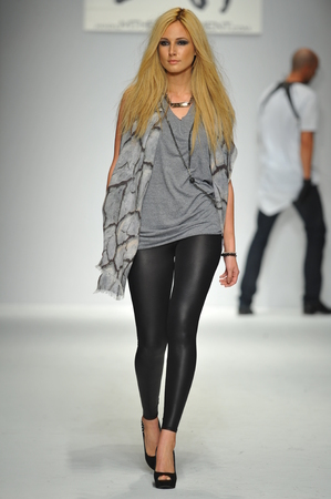 LOS ANGELES, CA - MARCH 11: A model walks runway at M The Movement show during Style Fashion Week Fall 2014 at The Live Event Arena on March 11, 2014 in Los Angeles Editoriali