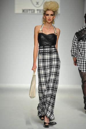 Los Angeles, CA - MARCH 11: A model walks the runway at Mister Triple X show during Style Fashion Week Fall 2014 at The LA Live Event Deck on March 11, 2014 in LA