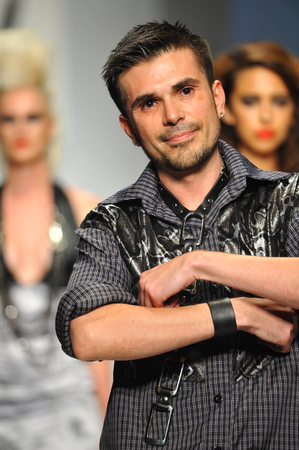 Los Angeles, CA - MARCH 11: Designer Erik Rosette walks the runway at Mister Triple X show during Style Fashion Week Fall 2014 at The LA Live Event Deck on March 11, 2014 in LA.