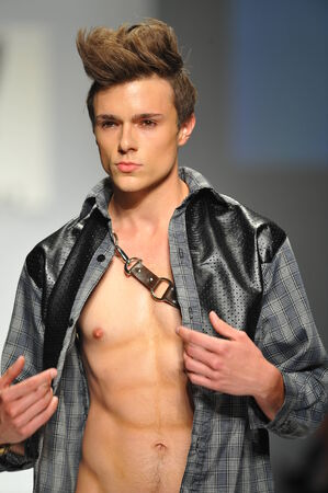 mister: Los Angeles, CA - MARCH 11: A model walks the runway at Mister Triple X show during Style Fashion Week Fall 2014 at The LA Live Event Deck on March 11, 2014 in LA