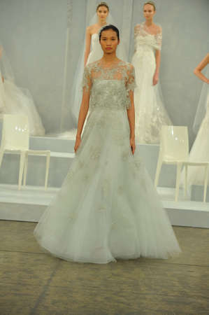 coverlet: NEW YORK, NY - APRIL 11: A model walks the runway during the Monique Lhullier Spring 2015 Bridal collection show at on April 11, 2014 in New York City.   Editorial