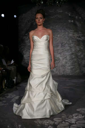 jenny: NEW YORK, NY - APRIL 12: A model walks the runway at the Jenny Lee Spring 2015 Bridal collection show on April 12, 2014 in New York City. Editorial