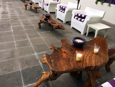 wooden chairs and tables in Cancun, Mexico photo