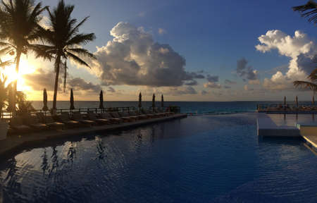 Panoramic view to the ocean at sunrize time in Cancun, Mexico photo