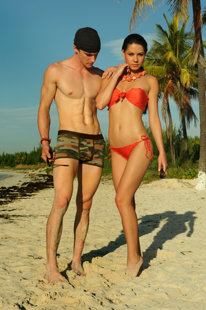 Young couple feeling happy at tropical beach photo