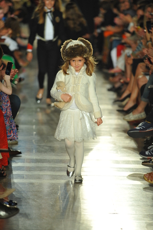 children's show: NEW YORK, NY - MAY 19: A model walks the runway at the Ralph Lauren Fall 14 Childrens Fashion Show in Support of Literacy at New York Public Library on May 19, 2014 in New York City.
