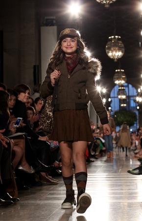 NEW YORK, NY - MAY 19: A model walks the runway at the Ralph Lauren Fall 14 Childrens Fashion Show in Support of Literacy at New York Public Library on May 19, 2014 in New York City.