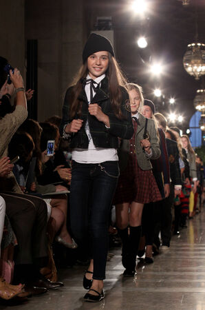 NEW YORK, NY - MAY 19: Models walk the runway finale at the Ralph Lauren Fall 14 Childrens Fashion Show in Support of Literacy at New York Public Library on May 19, 2014 in New York City.