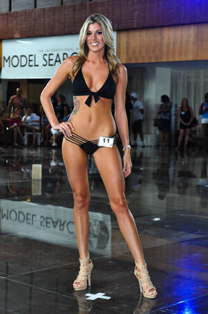 sens: CANCUN, MEXICO - MAY 04: A model walk the runway during IBMS - International Bikini Model Search 2014 at the Oasis Sens Resort on May 05, 2014 in Cancun, Mexico.