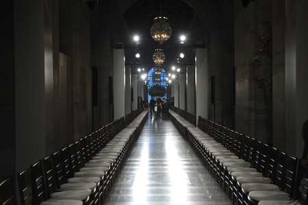 Empty runway with chairs and professional lighting