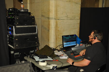 Sound and light engeneer at fashion show production booth
