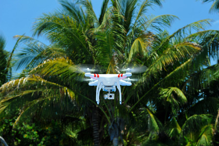 mounted: Quadcopter with mounted hd video camera on the air