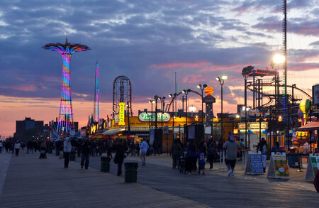 BROOKLYN, NEW YORK - MAY 31 Coney Island Boardwalk with Parachute Jump in the background on May 31, 2014 at Coney Island, NY The boardwalk, built in 1923, stretches for 2 51 miles