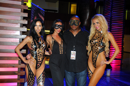 CANCUN, MEXICO - MAY 04: Founders of IBMS Elina and Patrick McKinley (C) with models  during  Black Tape Project at IBMS 2014 on May 04, 2014 in Cancun, Mexico.