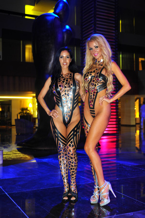 CANCUN, MEXICO - MAY 04: Models pose during preparation for Black Tape Project at IBMS 2014 on May 04, 2014 in Cancun, Mexico.