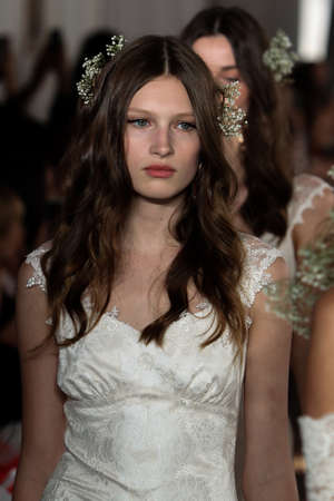 NEW YORK, NY - June 16: Models walk the runway finale at the Claire Pettibone Spring 2015 Romantique Bridal collection show on June 16, 2014 in New York City.