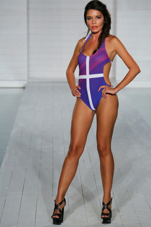 lila: MIAMI - JULY17: Model walks runway at Lila Nicole collection at SoHo Beach House during Miami Swim Fashion Week on July 17, 2014 in Miami Beach Florida.