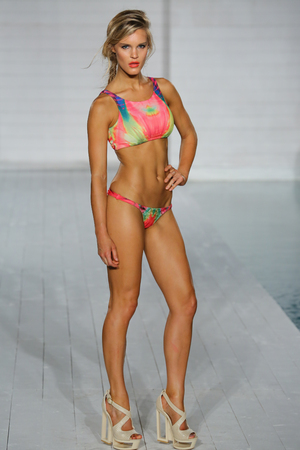 MIAMI BEACH, FL JULY 15: A Model Walks The Runway For Kya