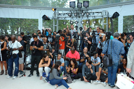 credentials: MIAMI BEACH, FL - JULY 21: Photographers platform the A.Z Araujo show during Mercedes-Benz Fashion Week Swim 2015 The Raleigh on July 21, 2014 in Miami Beach, Florida.  Editorial