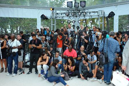 MIAMI BEACH, FL - JULY 21: Photographers platform the A.Z Araujo show during Mercedes-Benz Fashion Week Swim 2015 The Raleigh on July 21, 2014 in Miami Beach, Florida.  Editorial