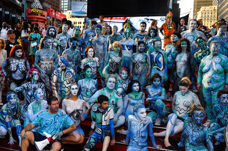 NEW YORK - JULY 26: Nude models, artists take Times Square during first official Body Painting Event featuring artist Andy Golub on July 26, 2014 in New York NY
