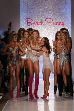 lacey: MIAMI - JULY 18: Designer Angela Chittenden (R) and models walk runway at Beach Bunny Swim collection during MBFW Miami Swim at Cabana Grande on July 18, 2014 in Miami Beach Florida
