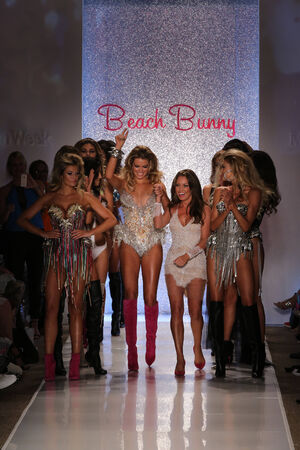 MIAMI - JULY 18: Designer Angela Chittenden (R) and models walk runway at Beach Bunny Swim collection during MBFW Miami Swim at Cabana Grande on July 18, 2014 in Miami Beach Florida