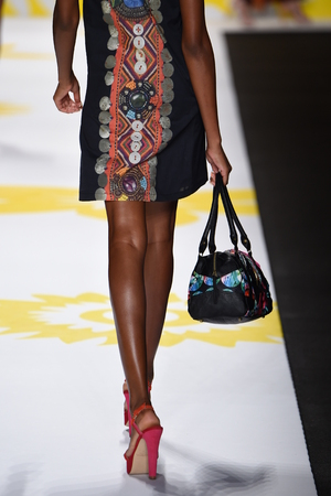 mini purse: NEW YORK, NY - SEPTEMBER 04: A model walks the runway at Desigual during Mercedes-Benz Fashion Week Spring 2015 on September 4, 2014 in New York City. Editorial