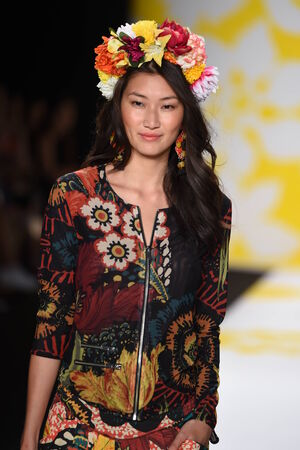 collarless: NEW YORK, NY - SEPTEMBER 04: A model walks the runway at Desigual during Mercedes-Benz Fashion Week Spring 2015 on September 4, 2014 in New York City. Editorial