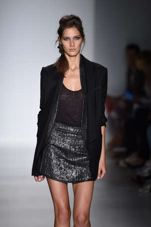 gunmetal:    NEW YORK, NY - SEPTEMBER 04: A model walks the runway at the Marissa Webb fashion show during Mercedes-Benz Fashion Week Spring 2015 on September 4, 2014 in New York City.