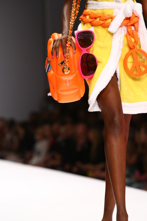 MILAN, ITALY - SEPTEMBER 18: A model walks the runway during the Moschino show as part of Milan Fashion Week Womenswear SpringSummer 2015 on September 18, 2014 in Milan, Italy.