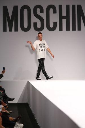 MILAN, ITALY - SEPTEMBER 18: Designer Jeremy Scott walks the runway during the Moschino show as part of Milan Fashion Week Womenswear SpringSummer 2015 on September 18, 2014 in Milan, Italy.