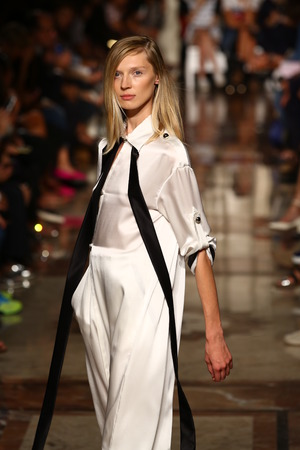 MILAN, ITALY - SEPTEMBER 17: A model walks the runway during the Andrea Incontri show as part of Milan Fashion Week Womenswear SpringSummer 2015 on September 17, 2014 in Milan, Italy.  Editorial