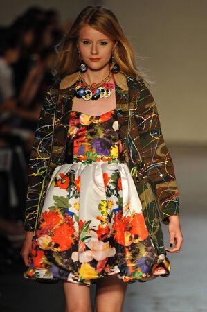 MILAN, ITALY - SEPTEMBER 18: A model walks the runway during the Leitmotiv show as a part of Milan Fashion Week Womenswear Spring 2015 on September 18, 2014 in Milan, Italy.