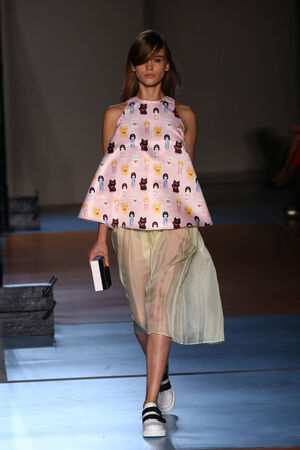 MILAN, ITALY - SEPTEMBER 21: A model walks the runway during the Au jour le jour show as part of Milan Fashion Week Womenswear Spring 2015 on September 21, 2014 in Milan, Italy.