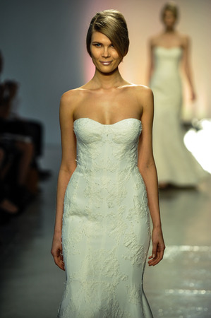 NEW YORK, NY - APRIL 11: A model walks the runway during the RIVINI Spring 2015 Bridal collection show at on April 11, 2014 in New York City.