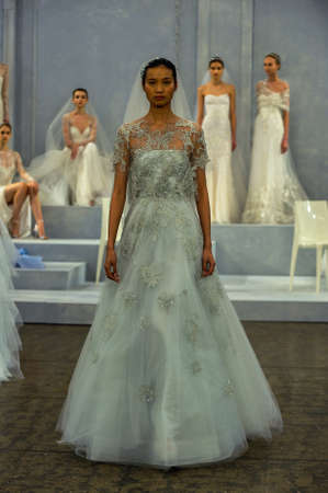 coverlet: NEW YORK, NY - APRIL 11: A model walks the runway during the Monique Lhullier Spring 2015 Bridal collection show at on April 11, 2014 in New York City.