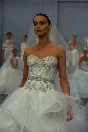 NEW YORK, NY - APRIL 11: A model walks the runway during the Monique Lhullier Spring 2015 Bridal collection show at on April 11, 2014 in New York City.