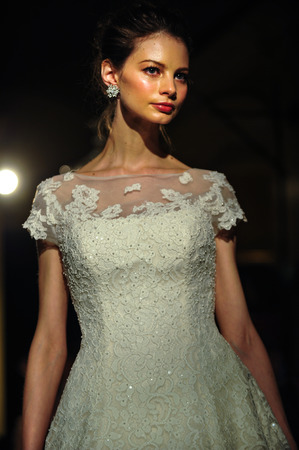 NEW YORK, NY - APRIL 11: A model walks the runway during Oleg Cassini Spring 2015 Bridal collection at the Plaza Athenee on April 11, 2014 in New York City.
