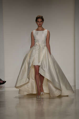 NEW YORK, NY - OCTOBER 10: A model walks the runway during the Anne Barge Fall 2015 Bridal Collection Show on October 10, 2014 in New York City.