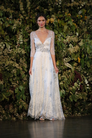 jeweled: NEW YORK, NY - OCTOBER 10: A model walks the runway during the Claire Pettibone Fall 2015 Bridal Collection Show on October 10, 2014 in New York City.