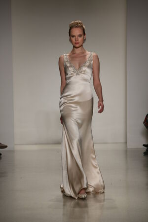 jeweled: NEW YORK, NY - OCTOBER 10: A model walks the runway during the Anne Barge Fall 2015 Bridal Collection Show on October 10, 2014 in New York City.