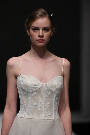 jenny: NEW YORK, NY - OCTOBER 12: A model walks the runway at the Jenny Lee Fall 2015 Bridal collection show at Pier 94 on October 12, 2014 in New York City. Editorial
