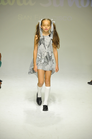 simone: NEW YORK, NY - OCTOBER 18: A model walks the runway during the Alivia Simone preview at petite PARADE Kids Fashion Week at Bathhouse Studios on October 18, 2014 in New York City. Editorial