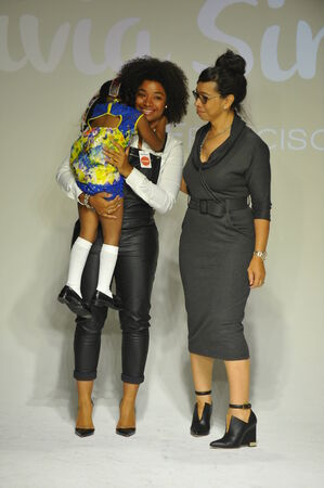 simone: NEW YORK, NY - OCTOBER 18: Shirley Newton (R) and Simone Colbert walk the runway during the Alivia Simone preview at petite PARADE Kids Fashion Week at Bathhouse Studios on October 18, 2014 in New York City. Editorial