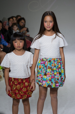 aria: NEW YORK, NY - OCTOBER 19: Models walk the runway during the Aria Childrens Clothing preview at petitePARADE  Kids Fashion Week at Bathhouse Studios on October 19, 2014 in New York City. Editorial