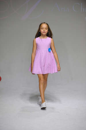 aria: NEW YORK, NY - OCTOBER 19: A model walks the runway during the Aria Childrens Clothing preview at petitePARADE  Kids Fashion Week at Bathhouse Studios on October 19, 2014 in New York City.