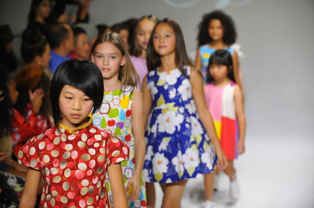 aria: NEW YORK, NY - OCTOBER 19: Models walk the runway finale during the Aria Childrens Clothing preview at petitePARADE  Kids Fashion Week at Bathhouse Studios on October 19, 2014 in New York City.