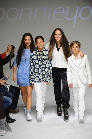 bonnie: NEW YORK, NY - OCTOBER 19: Designer Bonnie Young poses with Celia Babini, Kyah Cahill and Brando Babini on the runway during the Bonnie Young preview at petitePARADE Kids Fashion Week on October 19, 2014 in NYC.