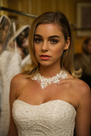 NEW YORK, NY - OCTOBER 09: A model getting ready backstage wearing Oleg Cassini Fall 2015 Bridal collection at the Plaza Athenee on October 09, 2014 in New York City.